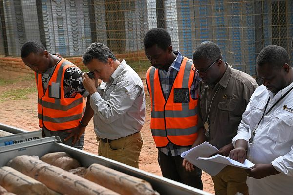 Fabrice Matheys (G.M Loncor Resources) and senior geologists Bel Mapendo and Patient Zamakulu inspecting drill core at Adumbi core shed where all core is stored
