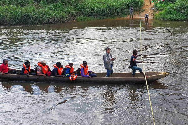 Fabrice Matheys, Loncor's General Manager in DRC crossing the Imbo River with exploration team to undertake soil sampling at Imbo East prospects