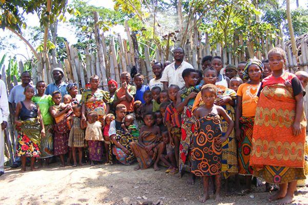 Yindi community of Pygmies look on as the Loncor Foundation donates clothing to the community.